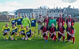 The Ref and The Players - The North (in Red/Black) The South (in Yellow/Blue)