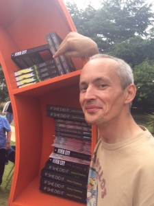 Graeme Cameron pointing to his book NORMAL